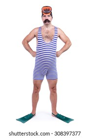 Man in striped retro swim dress standing with hands on hips. Diver with snorkeling equipment in vintage swimsuit isolated on white background.