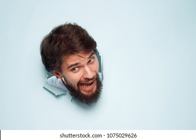 man stuck his head in the wall, torn background, emotions, free place