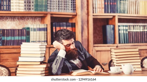 man studies book at his desk in the office