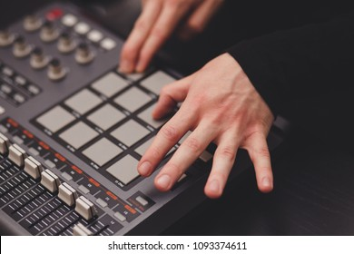 man in the studio creates electronic music