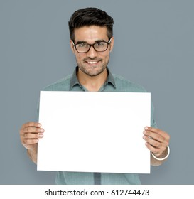 Man in a studio shoot holding placard