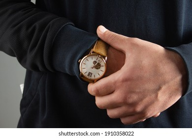 man in the studio shows a wristwatch