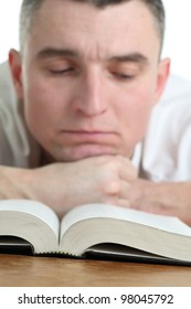 Man studying the Bible. Focus on the Bible