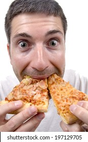 A man stuffing his mouth with two slices of pizza.