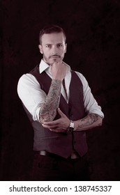 man with stylish suit and tattoos