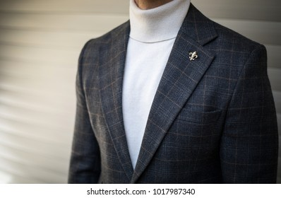 Man in stylish turtleneck sweater suit posing  outdoors