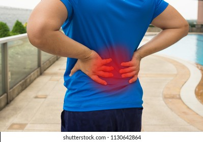 Man suffered with back pain from exercise.