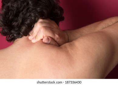 Man suffering from back neck ache, muscle pain
