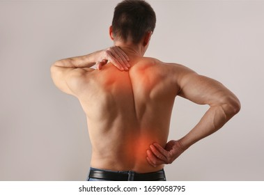 Man suffering from back and neck pain. Chiropractic, Physiotherapy concept