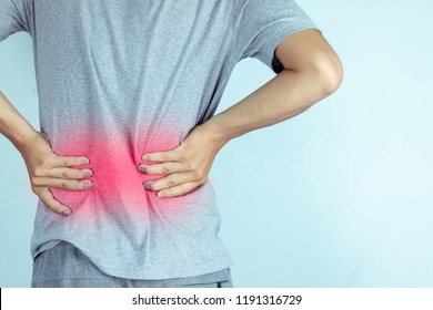 man suffering from backache,Lower back pain.