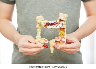 Man suffering from constipation and abdominal pain. Treatment of colitis, flatulence, indigestion
