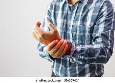 man suffering from elbow joint pain people /  healthcare and problem concept