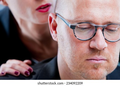 man suffering a harassment by a woman (focus on man)