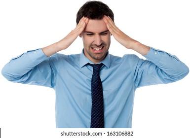 Man suffering from headache wincing