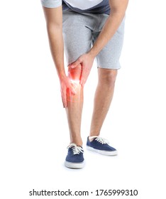 Man suffering from knee pain on white background, closeup