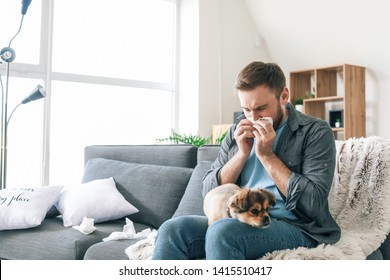 Man suffering from pet allergy at home