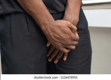 man suffering from prostate cancer; sick african man with prostate cancer, premature ejaculation, fertility, bladder problem; health care, sickness, cancer concept; adult african man, black man model