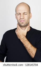 Man suffering from throat problems