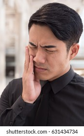 man suffering from toothache, oral problem
