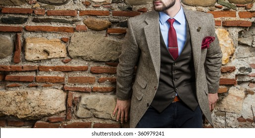 Man in suit agains the wall