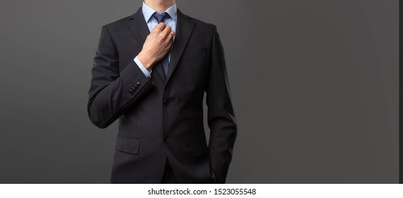 Man in suit against gray background