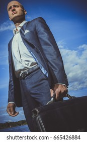 A man in a suit with a briefcase goes along