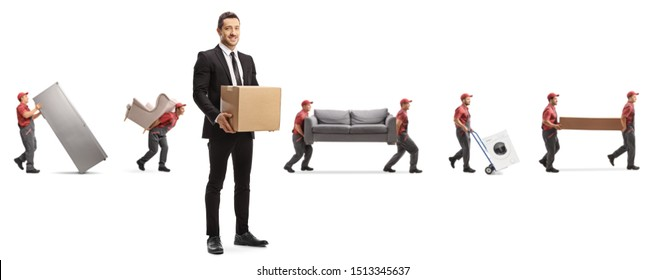 Man in a suit with a cardboard box and workers from a moving company carrying home appliences and furniture isolated on white background