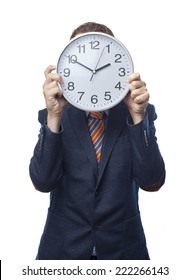 Man in suit with a clock