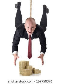Man in suit dropping down to grab money isolated on a white background