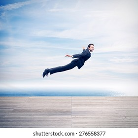 Man in suit flying