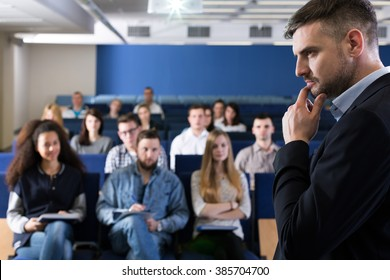 Man in suit giving lecture on university for young students