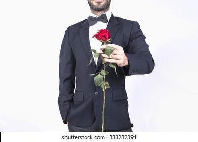 Man in suit giving a red rose