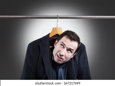 Man in suit hanging in the wardrobe