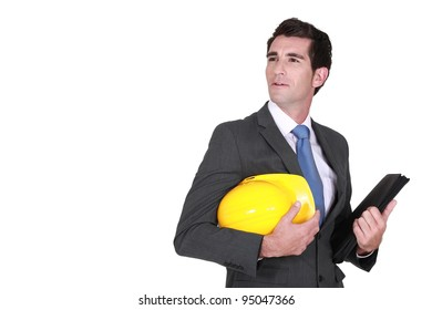 Man in a suit and helmet with folder
