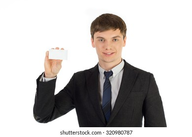 man in a suit holding a business card on a white background