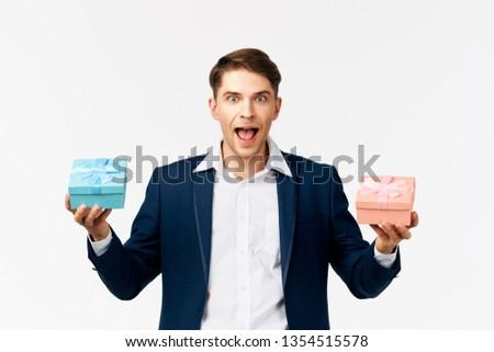e5d42c5a16e6c Man Suit Holding Gift Boxes His Stock Photo (Edit Now) 1354515578 ...