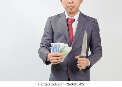 Man in suit holding knife and korean won bank note