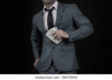 Man in suit holding money bills