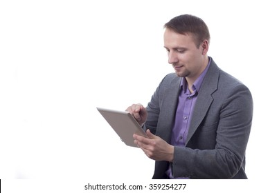 Man in suit, holding tablet, isolated on white