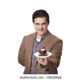 Man in suit holds cake, isolated on white