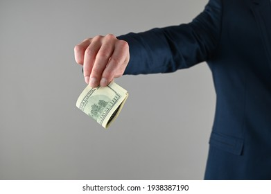 a man in a suit holds money in his hands . High quality photo