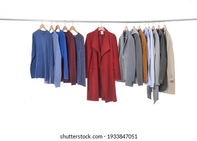 Man suit, jacket with scarf ,sweaters of different colors on hanger
