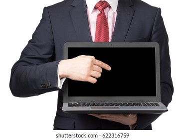 man in suit with laptop standing on white background