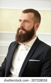 man in a suit with a long beard