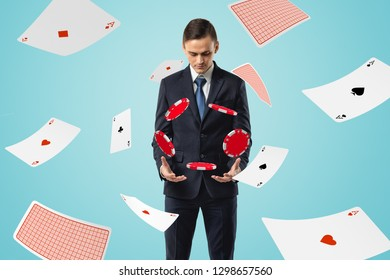 Man in suit looking down at poker chips floating in air with aces flying all around. Successful game. Lucky player. Gambling addiction.