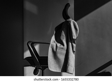 Man in suit looking out of window