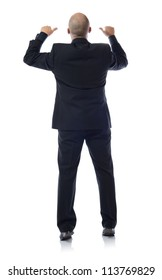 Man in a suit looking over a wall or sign copy space