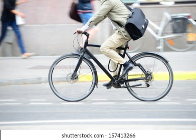 Man in suit on bike in profile