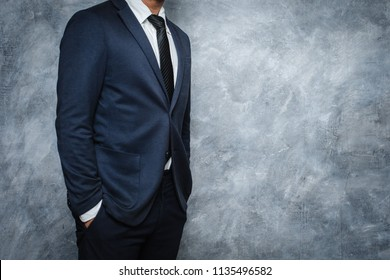 man in suit on a concrete wall background,Business concept