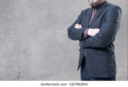 A man in suit on a concrete wall background